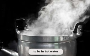 Idioms: To be in hot water