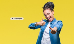 Young braided hair african american girl wearing glasses over isolated background approving doing positive gesture with hand, thumbs up smiling and happy for success. Looking at the camera, winner gesture.